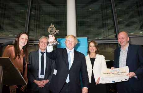 The Mayor's Community Reception Lewisham and Greenwich and Team London Awards, London's Living Room, City Hall. Mayor Boris Johnson holding award together with Team London and James Banks of GLV who is holding certificate for London being voted European Voluntary Capital 2016. Photo: Eleanor Bentall.